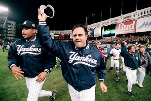 New York Yankees manager Joe Torre celebrates his team's World Series victory.